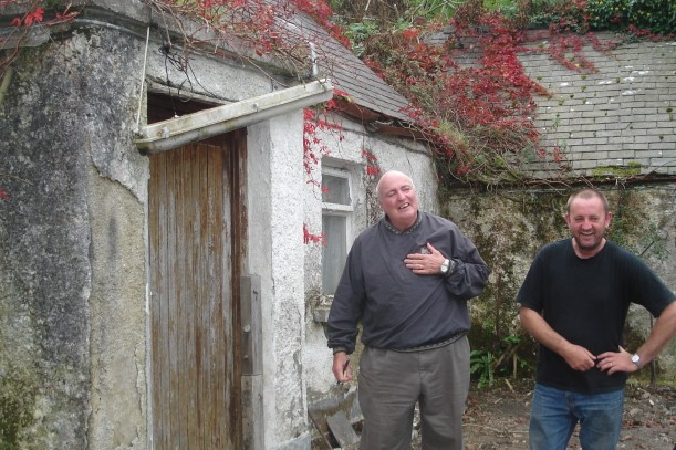 The Jimmys having a laugh outside the old house