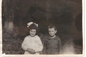 Agnes, with her younger brother, Frank McMahon -- ca 1920