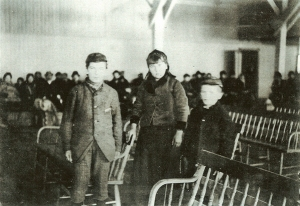 Annie Moore with brothers Anthony and Philip, Ellis Island, 1892
