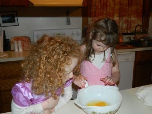 Ainsley (and her hair) baking with Maryn at my house