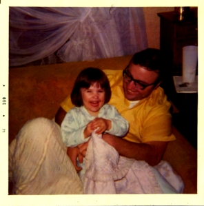 Dad with his first born, Regan, in December 1971.